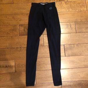 Nike black leggings with metallic writing on leg